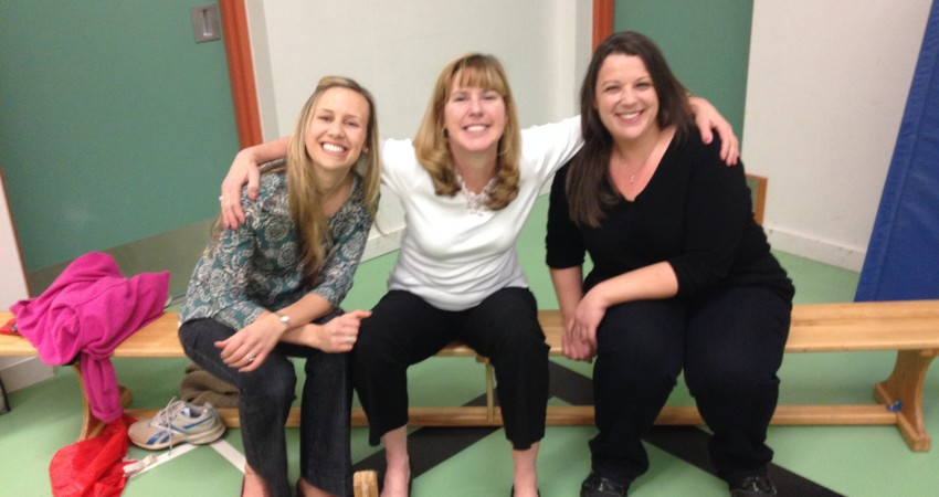 Ms. Rogers, Mrs. MacDonald & Ms. Cardin taking a break during Students vs Staff Floor Hockey Game